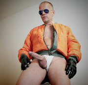 German skin hunk in bomber jacket and jockstrap is presenting his big package in front of the cams....