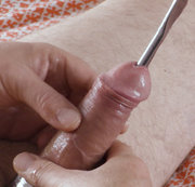 A 6 minute clip of a solo male urethral sounding session using the Dittle number 26. I