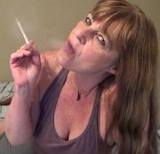 Dangling my cigarette from my lips as I talk filthy to you wanting you to wank that cock for me as...