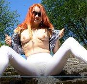 Peeing in white leggins in a public park