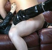 Leather Clad Pierced and Tattooed English Milf