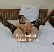 Self-fucked in black nyons