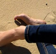 Beautiful Feet in the Beach Sand